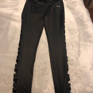 black leggings with crosses on the side